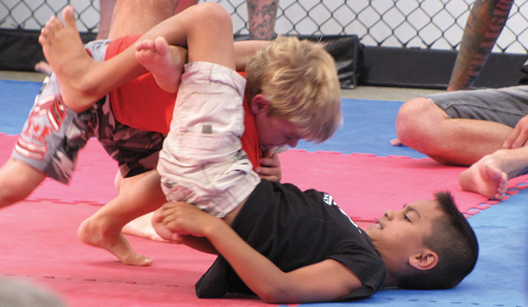 children in mixed martial arts Try your first kids martial arts class free our program combines karate, boxing, muay thai, wrestling, jiu jitsu, and more.